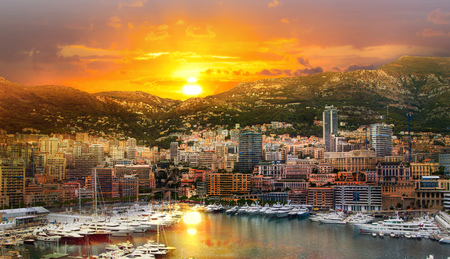 Monaco at sunset. Main marina of Monte Carlo with luxury yachts and sail boats at sunset Foto de archivo
