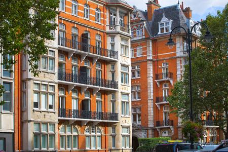 London, UK - September 8, 2016: Windows of the luxury apartments in Kensington. Centre London residential buildings.  Kensington church street.