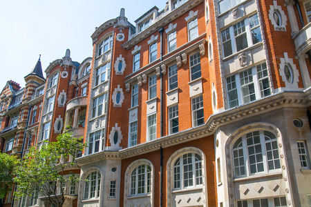 LONDON, UK - 25 August, 2017: Elite properties of London. Facade of residential buildings in the Kensington, one of the most expensive places to live in UK. Gloucester street.
