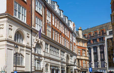 old english: LONDON, UK - 25 August, 2017: Elite properties of London. Facade of residential buildings in the Kensington, one of the most expensive places to live in UK. Gloucester street.