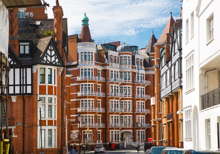 old english: LONDON, UK - 25 August, 2017: Facade of the residential buildings in Kensington, the one of the most expensive places to live in UK