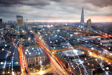 City of London view at night, business network connections concept.
