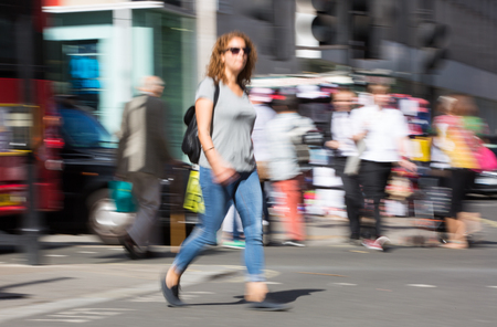 LONDON, UK - June 9, 2017: Blurred image of walking people with shopping bag at Oxford street, the main destination for shopping at Westend.