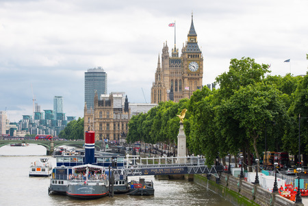 city park boat house: LONDON, UK - August 24, 2017: The River Thames Embankment. View includes Big Ben and Houses of Parliament Editorial