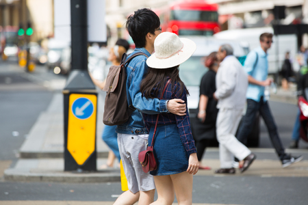 London, UK - August 24, 2016: Young Chinese couple crossing the Piccadilly circus junction Stock fotó - 88873360