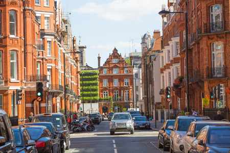 London, UK - September 8, 2016: Residential aria of Mayfair with row of periodic buildings. Luxury property in the centre of London.