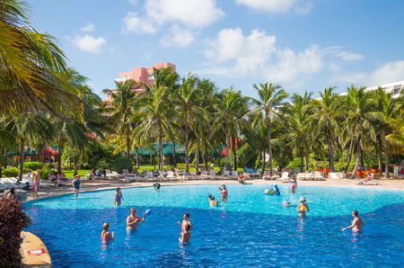 Mexico, Cancun - February 15, 2018: Grand Pyramid entertaining complex. Grand Oasis hotel swimming pool with people and kids playing in water