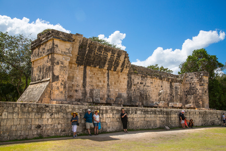 Mexico, Yucatan, Chichen Itza - February 17, 2018: Mayan Great Ball court and Temple of Jaguar. Editorial