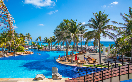 Mexico, Cancun - February 15, 2018: Grand Pyramid entertaining complex. Swimming pool and people relaxin by the water.