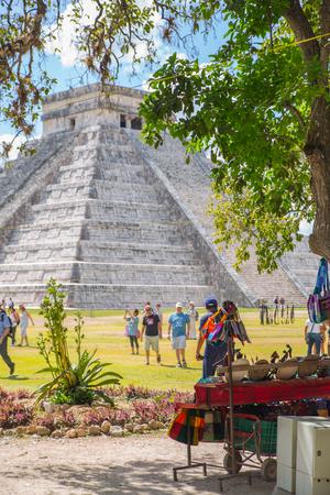 Mexico, Yucatan - February 17, 2018: Chichen Itza, Mayan pyramid of Kukulcan El Castillo and souvenirs stall Editorial
