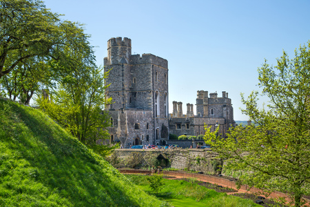 Windsor, UK - May 5, 2018: View at the medieval Windsor Castle, built 1066 by William the Conqueror. Official residence of Queen. Berkshire, England UK