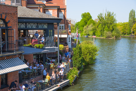 Windsor, UK - May 5, 2018: River side restaurant in Eton with lots of people and tourist chilling out.