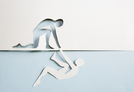 Abstract people helping to get out of problems. Paper cut composition