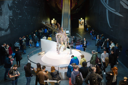 London, UK - March 11, 2018: Dinosaurs display in National history museum and lots of people around the artefact Sajtókép