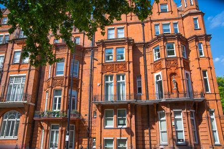 London, UK: Residential aria of Kensington and Chelsea. Cadogan gate with row of periodic buildings. Luxury property in the centre of London.