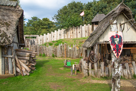 Essex, UK - 31 August, 2018: Trading houses in the Norman village. Reconstruction of 1050th. Educational centre for kids demonstration everyday life and skills