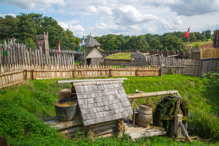 Essex, UK - 31 August, 2018: Ducking stool, torture tool in the Norman village reconstruction, educational centre for kids with historical activities and every day medieval life experience Éditoriale