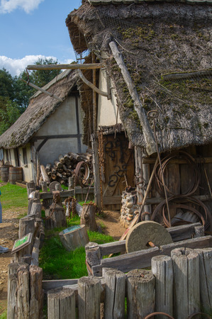 Essex, UK - 31 August, 2018: Training houses in the Norman village. Reconstruction of 1050th. Educational centre for kids demonstration everyday life and skills Éditoriale