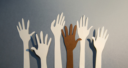 Humans hands raised up to the sky. Help, support, care and togetherness concept