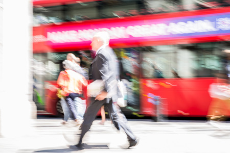 LONDON, UK - 26 June, 2018: Beautiful motion blur of old man walking in the Regent street in summer day. Busy life of the capital. Editorial