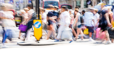 LONDON, UK - 26 June, 2018: Beautiful motion blur of people, walking in the Regent street in summer day. Busy life of the capital.
