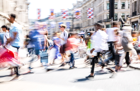 LONDON, UK - 26 June, 2018: Beautiful motion blur of people, walking in the Regent street in summer day. Busy life of the capital. Editorial
