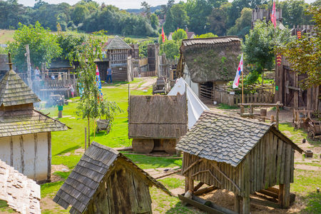 Essex, UK - 31 August, 2018: Norman village reconstruction, dated back to 1050. Educational centre for kids with demonstration of everyday life and skills medieval time Editoriali