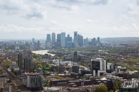 London, UK - 25 April, 2019: Canary Wharf office buildings, famous London's skyscrapers and East London view with