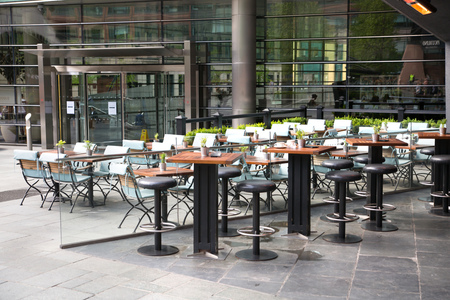 London, UK - 25 April, 2019:  Empty restaurant in the city of London Editorial