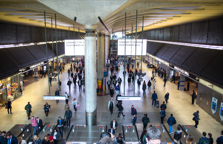 London, UK - 25 April, 2019: Canary Wharf tube station with lots of people. Commuters, office workers arriving at Canary Wharf early morning