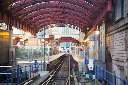 London, UK - 25 April, 2019: Canary Wharf  DLR light rail way track and station at sunset