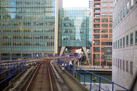 London, UK - 25 April, 2019: DLR light rail way track at sunset going towards Canary Wharf
