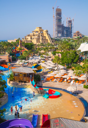 Dubai, UAE, United Arab Emirates - 29 May, 2019:  View of Aquaventure Water Park and people playing in the pool. The waterpark in Atlantis The Palm locates at the Palm Jumeirah of UAE. Editorial