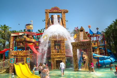Dubai, UAE, United Arab Emirates - 28 May, 2019: Atlantis Aquaventure water park locates on the Palm Jumeirah. People playing in the water playground zone Editorial