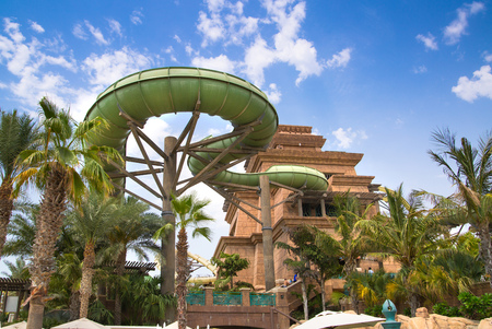 Dubai, UAE, United Arab Emirates - 29 May, 2019:  View of Aquaventure Water Park, Neptune tower and people playing in the pool. Atlantis The Palm locates at the Palm Jumeirah of UAE. Editorial