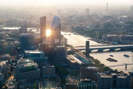 London, UK. City of London at sunset. Aerial view include London skyscrapers and river Thames 免版税图像