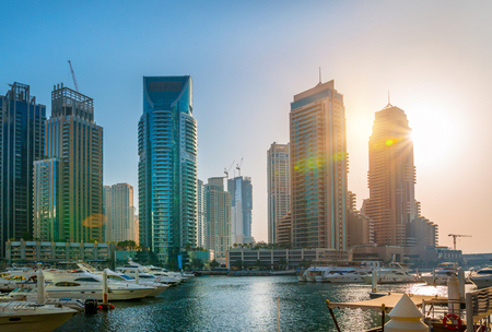 Dubai, UAE United Arabs Emirates - 29 May, 2019: Dubai marina skyscrapers and yachts at sunset. Apartments, hotels and office buildings, modern residential development of UAE Editorial
