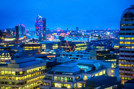 London, UK - 26 April, 2019: City of London at night with lots office buildings lights.  View from roof garden at the west part of the City