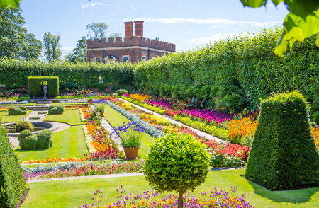 London, UK - July 29, 2019:  West London Bushy park. Beautiful english garden view, with lots of trees and flowers. English nature.