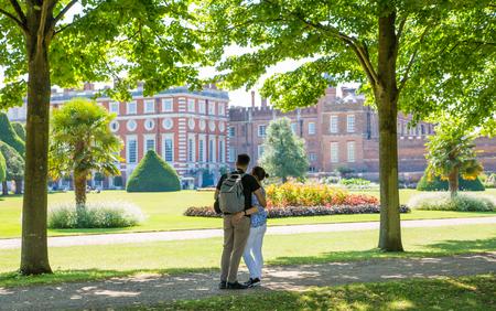 London, UK - July 29, 2019:   West London Bushy park. Beautiful english garden view, with couple enjoying the view Editorial