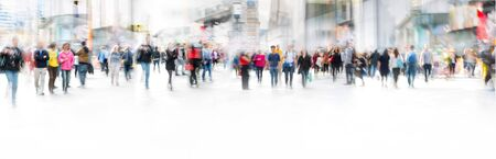 Panoramic blurred background with lots of people, office workers and tourists walking in the Leicester square, London. Busy life concept, business and travel.