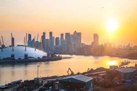 London, UK - August 27, 2019: Canary Wharf, river Thames and London Arena view at sunset. Foto de archivo - 129659452