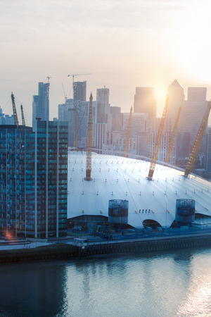 London, UK - August 27, 2019: Canary Wharf, river Thames and London Arena view at sunset. Foto de archivo - 129659459