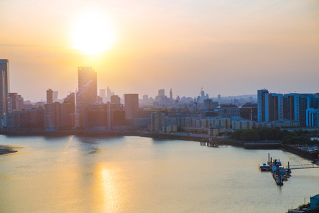 London, UK - August 27, 2019: Canary Wharf, river Thames and London Arena view at sunset. Foto de archivo - 129659461