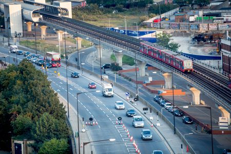 London, UK - August 27, 2019: Roads and railway of East London. View from the cable cars Foto de archivo - 129659474