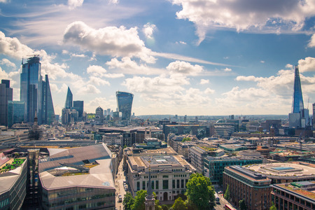 London, UK - June 20, 2019: City of London view from the St. Paul's cathedral at sunny summer day. View includes skyscrapers of banking and offie area Foto de archivo - 129746157