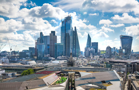 London, UK - June 20, 2019: City of London view from the St. Paul's cathedral at sunny summer day. View includes skyscrapers of banking and offie area Foto de archivo - 129746159