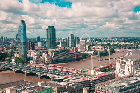 London, UK - June 20, 2019: City of London view from the St. Pauls cathedral at sunny summer day. View includes skyscrapers, Thames river and London bridges. 報道画像