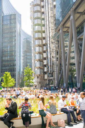 London, UK - 26 June, 2019: Business people and office workers walking next to Lloyds building in the City of London during lunch time Editorial