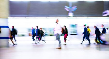 Motion blur of walking people. People on the way to work, rushing through the underground tunnel. London, UK Stock Photo